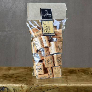 Nougat enrobé chocolat au lait écorce d'orange - Sachet 400gr